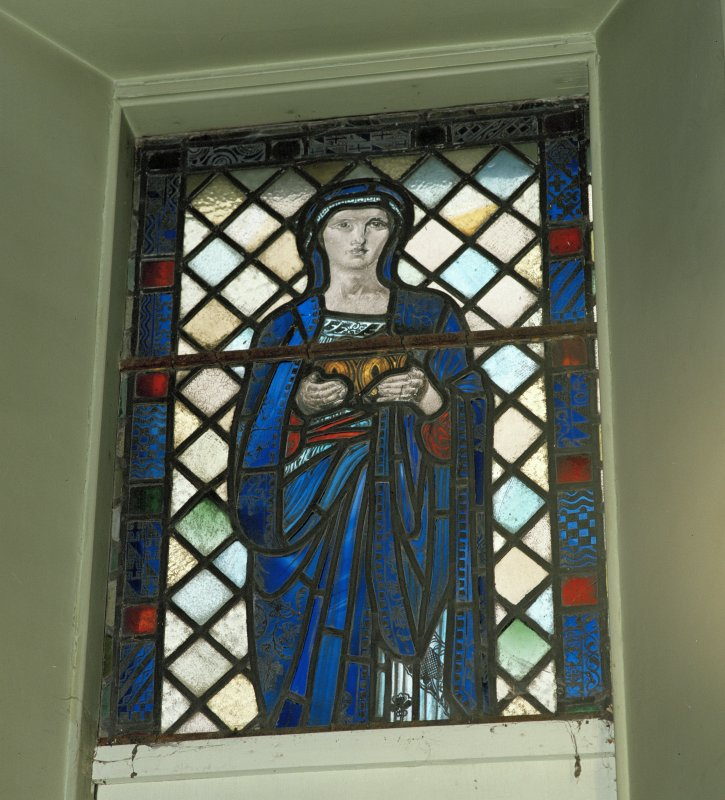 View of reused stained glass window depicting a lady to the East of the organ..