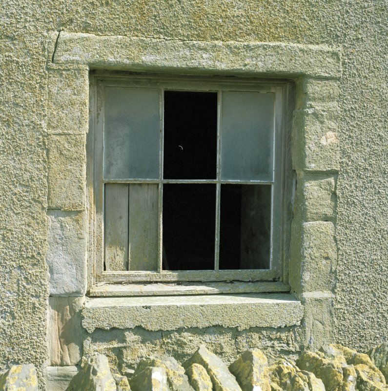 Detail of window at basement level of E gable.