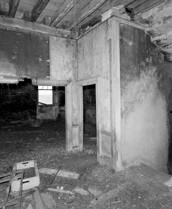 Interior. First floor, view of remains of partitioning from SW.