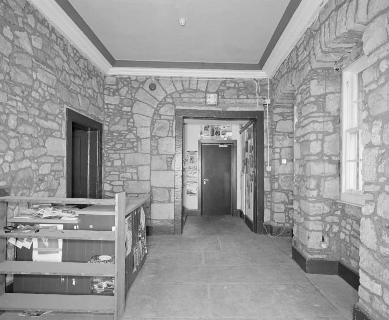 Interior. Tolbooth View of first floor tower entrance hall from East showing blocked archway