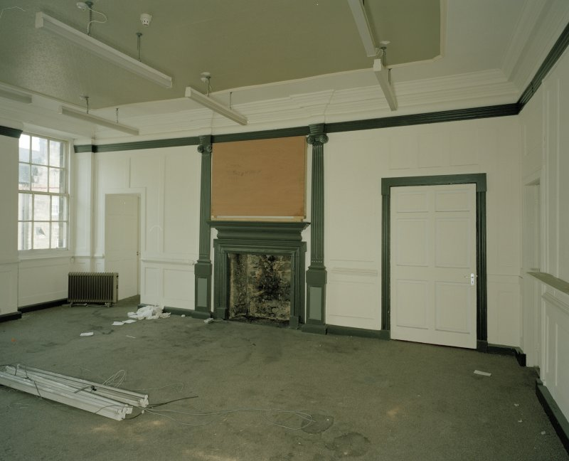 Interior. Tolbooth View of first floor North room from Northh West showing paneling and original fireplace
