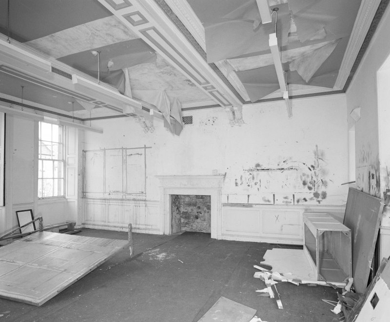 Interior. Tolbooth View of first floor South room from North West showing later eighteenth century fireplace and dado
