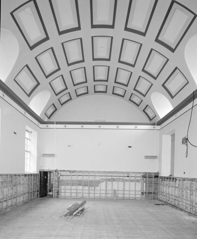 Interior. View of first floor assembly hall from West showing vaulted coffered ceiling