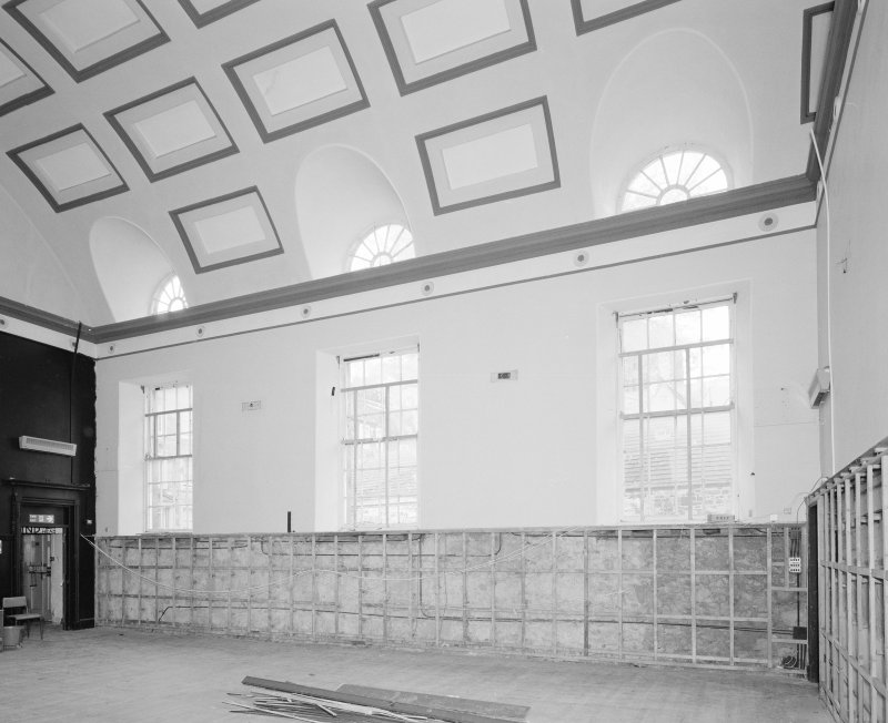 Interior. View of first floor assembly hall from North showing vaulted coffered ceiling and windows
