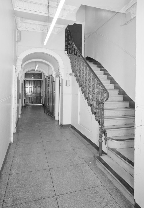 View of entrance hall and staircase from S