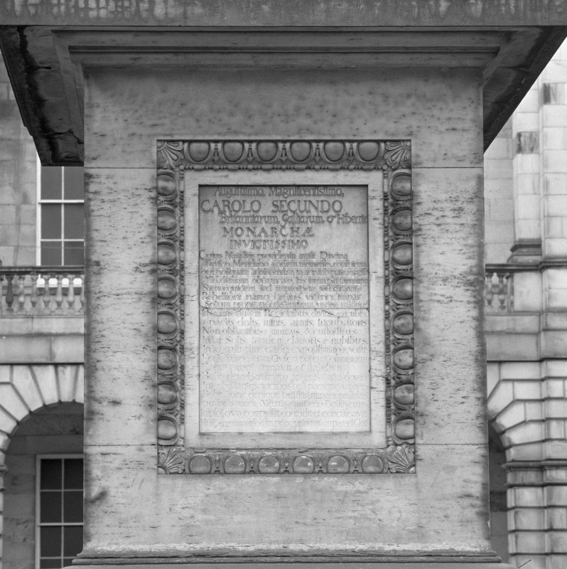 Detail of plaque on plinth.