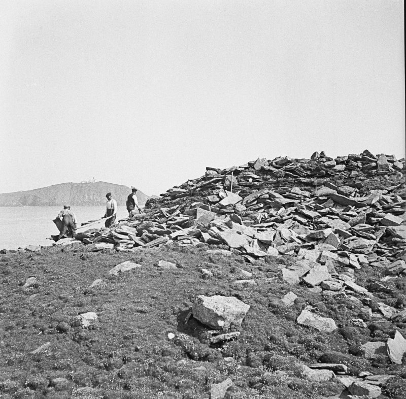 View of Ness of Burgi blockhouse with Sumburgh Head in the background.