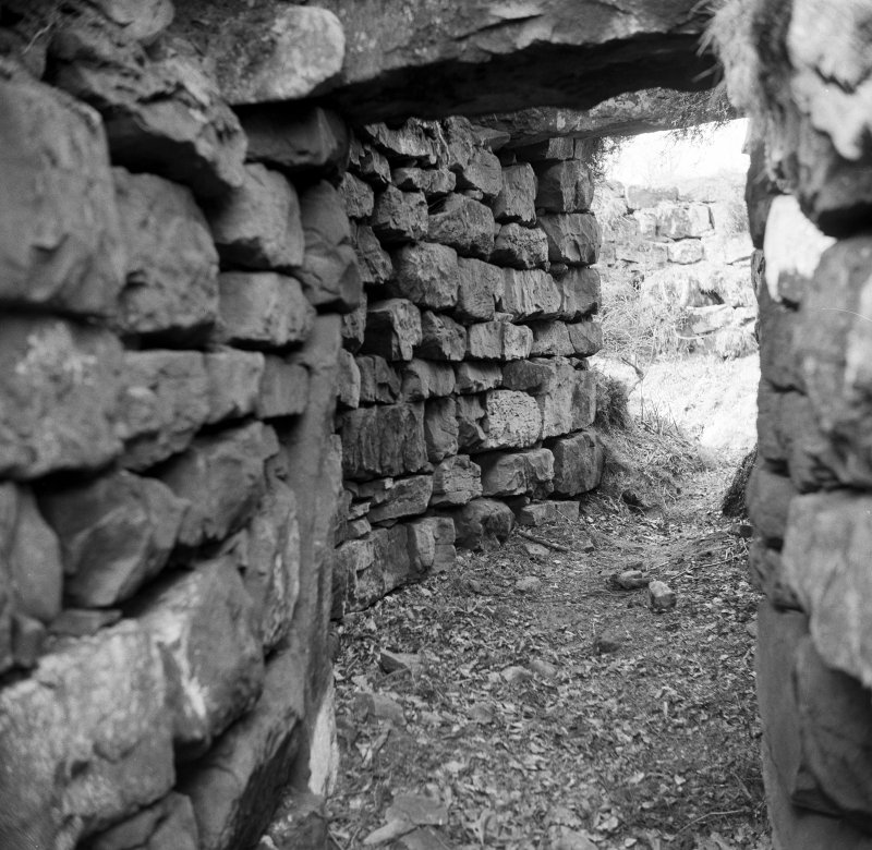 Publication photograph: entrance passage from outside, Torwood Broch.
