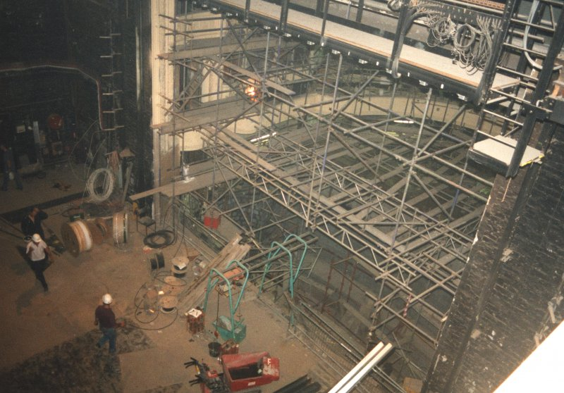 Interior. View from fly floor showing stage and auditorium undergoing restoration.