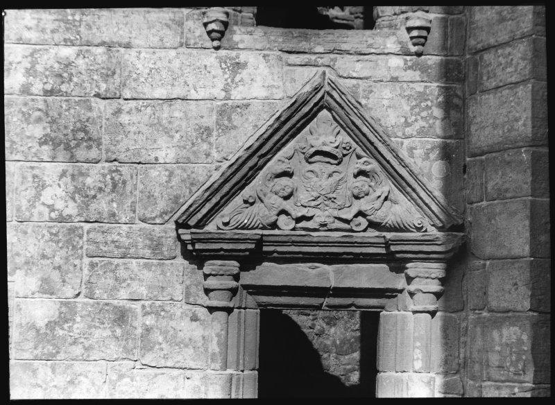 Detail of carved tympanum of window pediment.