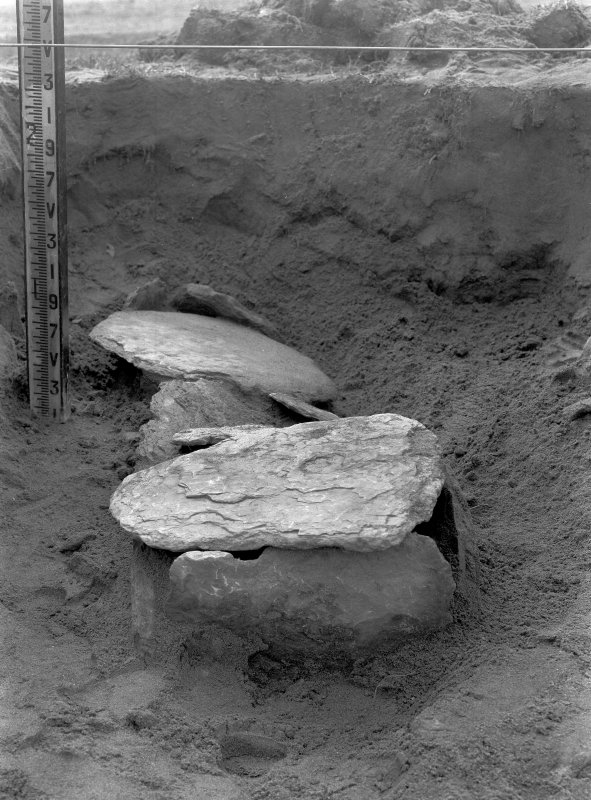 Excavation Photograph: Intrusive cist.