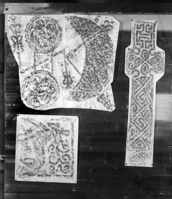 Photographic copy of three rubbings. The upper left rubbing shows the upper detail and the lower left rubbing shows the lower left detail of the reverse of Aberlemno No. 3 Pictish symbol stone, Angus. The right rubbing shows the face (b) of a cross slab from Kilmartin Churchyard, Argyll.