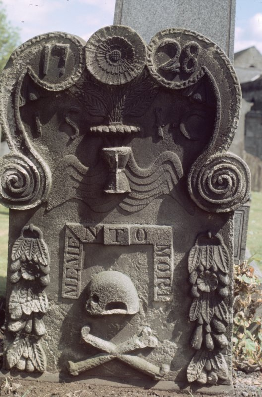 View of headstone dated 1728 with skull, crossbones and scroll decoration, Holy Rude, Stirling.