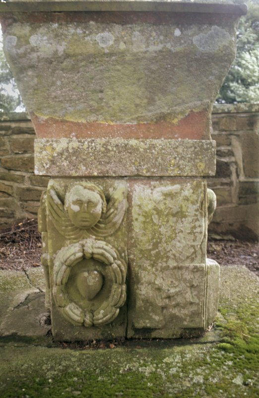 View of font constructed from old gravestones, Dalgarnock Church.