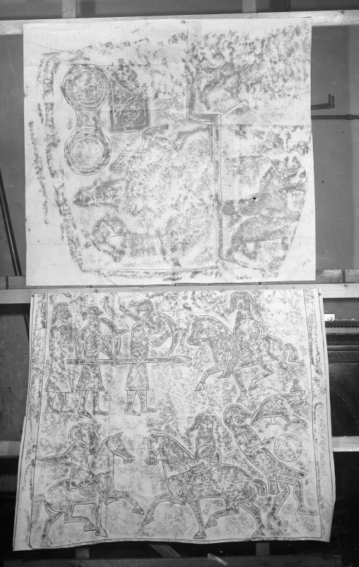 Photographic copy of two rubbings. The top rubbing shows upper detail of reverse of Pictish cross slab, originally from Woodrae Castle, Angus, now at National Museums of Scotland. The bottom rubbing shows detail of reverse of Aberlemno no.2 Pictish cross slab, Aberlemno Churchyard, Angus.