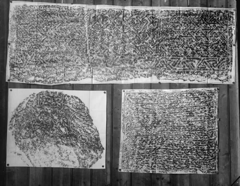 Photographic copy of three rubbings. The top rubbing shows detail of face of Rosiemarkie no.2  carved stone, Rosemarkie Parish Church. The bottom left rubbing shows detail from a fragmented Pictish symbol stone, originally from Newbigging Farm, Leslie, now in the garden of Leith Hall. The bottom right rubbing shows detail of face of  Farr cross-slab, Clachan.