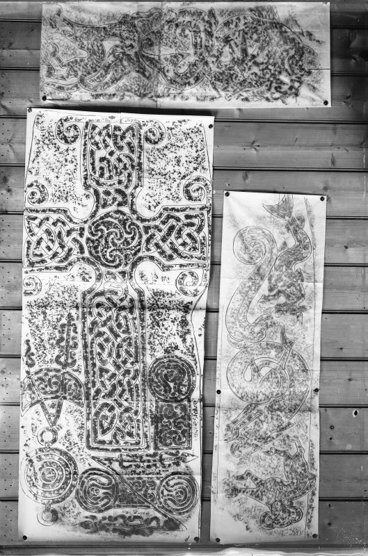 Photographic copy of three rubbings. The upper rubbing shows the lower right panel detail, and the right rubbing shows the lower left panel of face of Meigle no. 1 Pictish cross slab, now in Meigle Museum. The left rubbing shows detail of face of Dyce no.2 Pictish cross slab, Chapel Of St Fergus, Dyce.