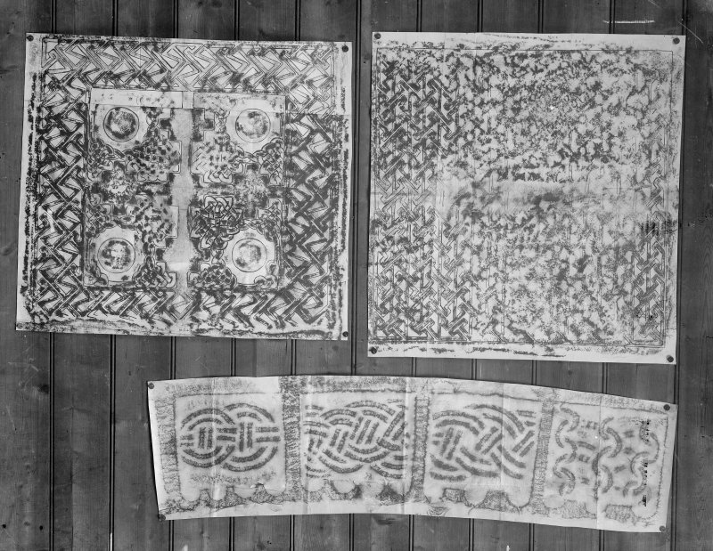 Photographic copy of three rubbings. The top rubbings show details of reverse of Rosiemarkie no.1 Pictish cross slab, now at Groam House Museum, Rosemarkie. The bottom rubbing is unidentified.