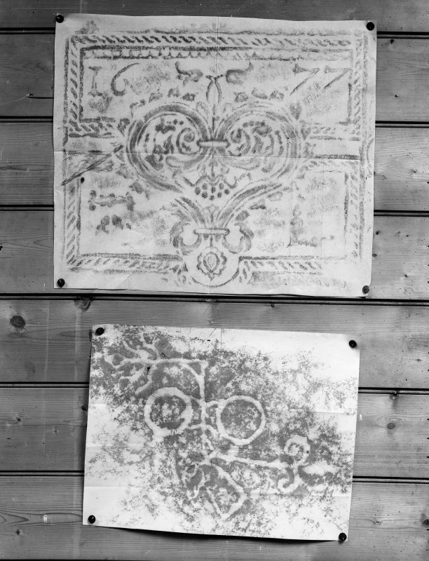 Photographic copy of two rubbings. The upper rubbing is of an unidentified panel, bearing the date 1677. The lower rubbing shows the double disc and Z-rod and beast's head Pictish symbol carvings in Doo Cave, East Wemyss.