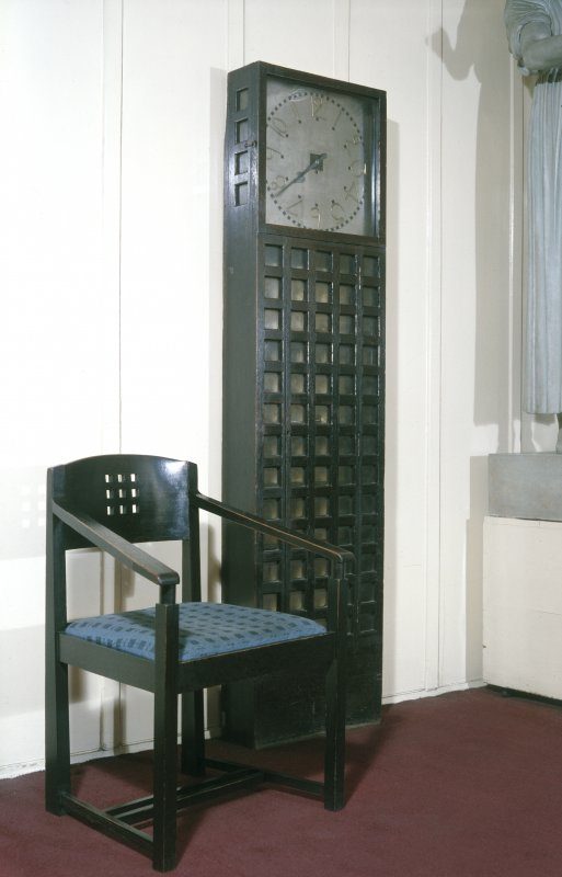 View of clock and chair in Glasgow School of Art.