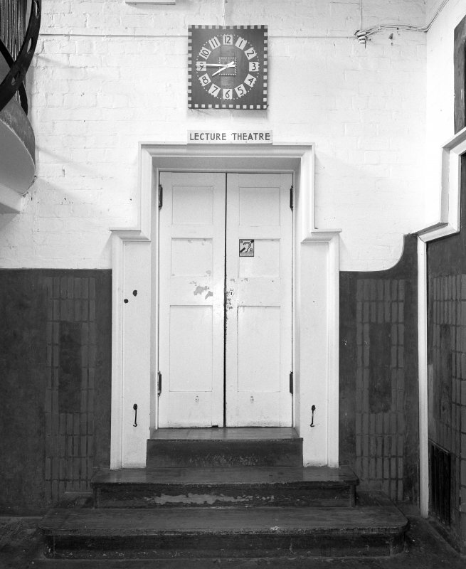Interior view of Glasgow School of Art showing lecture theatre door in basement from E.