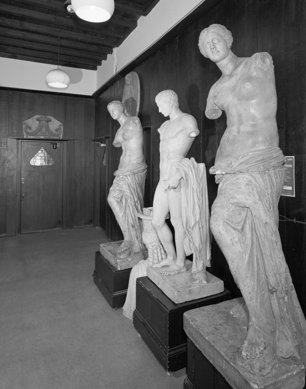 Interior view of Glasgow School of Art showing statues at E end of E corridor on ground floor.