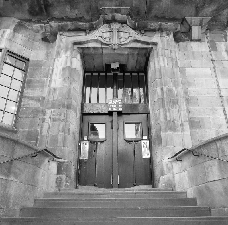 View of main doorway at N facade of Glasgow School of Art from N.
