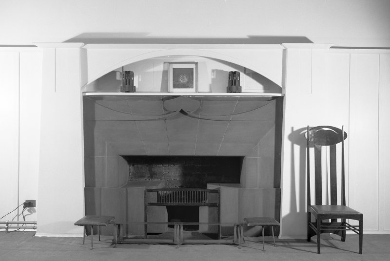 Interior view of Glasgow School of Art showing fireplace and chair.
