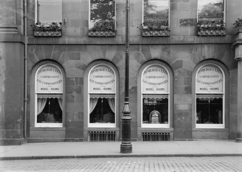 Detail of ground floor windows showing model rooms for the Edinburgh and Leith Corporations Gas Commissioners, 25 Waterloo Place, Edinburgh.