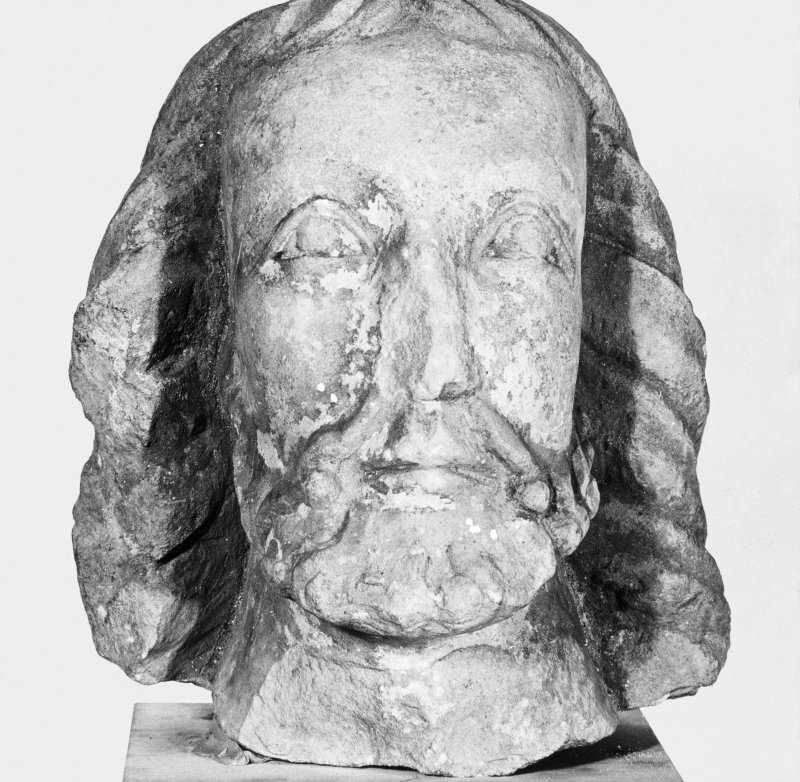 Carved head.
