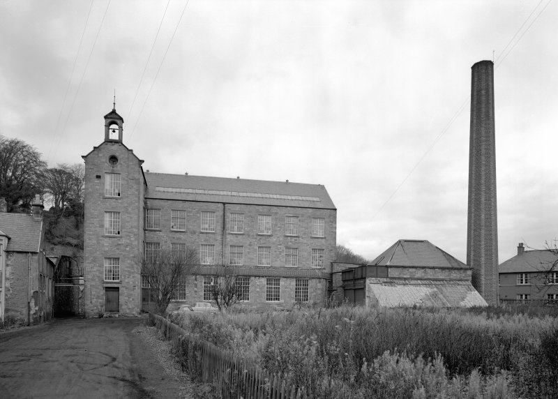 View of main and ancillary buildings with chimneystack, Bongate Mill, Jedburgh, from south