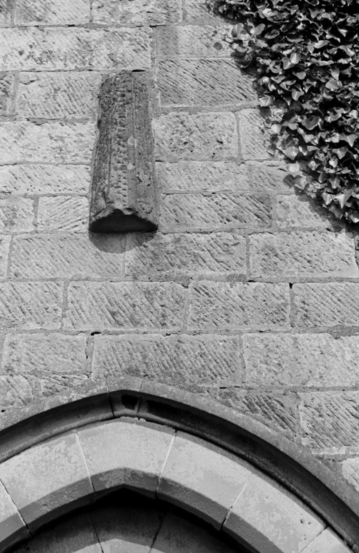 St Kentigern's Church. Detail of hog backed stone reset over West door.