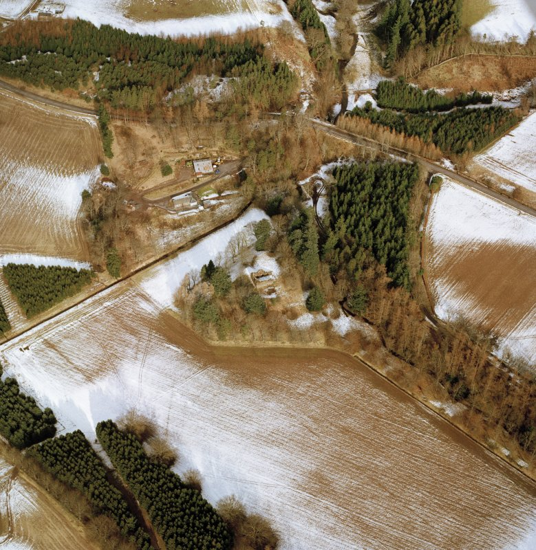 Oblique aerial view centred on the remains of the possible motte and tower-house, taken from the SSW.
