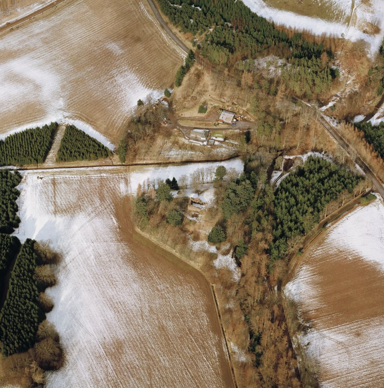 Oblique aerial view centred on the remains of the possible motte and tower-house, taken from the SSE.