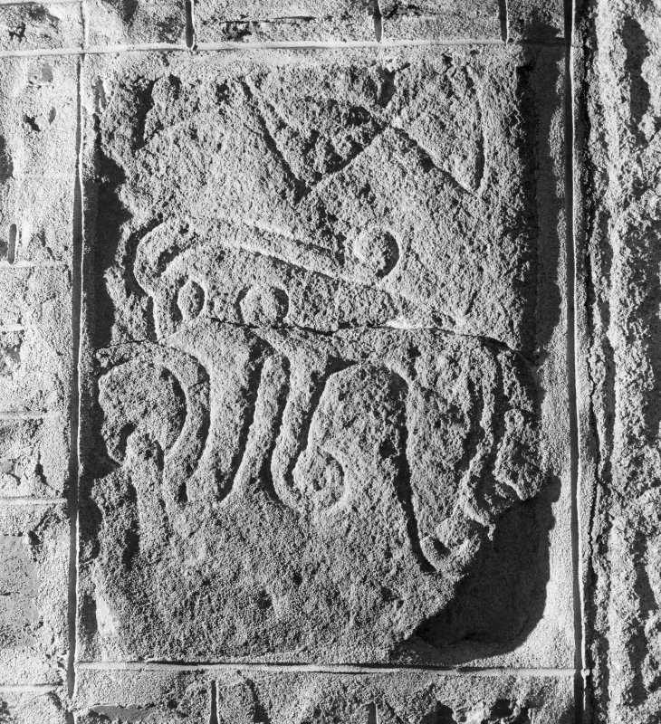View of Fyvie no.1 Pictish symbol stone built into wall of church.