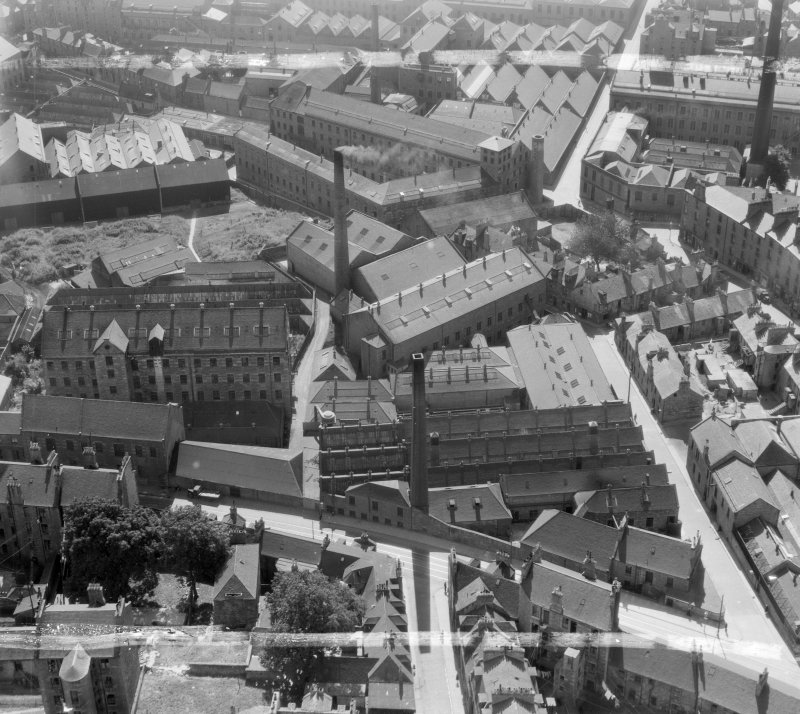 HR Carter & Sons, Dundee, Angus, Scotland, 1947. Oblique aerial photograph taken facing South. This image was marked by Aerofilms Ltd for photo editing.