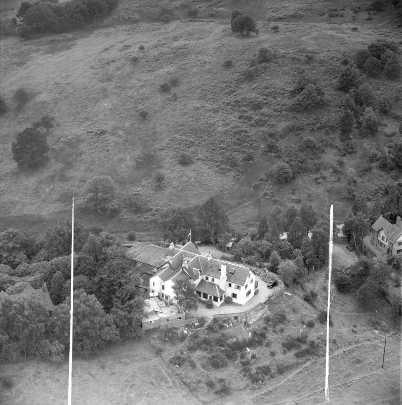 """""Covenanters Inn"""", Aberfoyle, Perthshire, Scotland, 1953. Oblique aerial photograph taken facing South/West. This image was marked by Aerofilms Ltd for photo editing."
