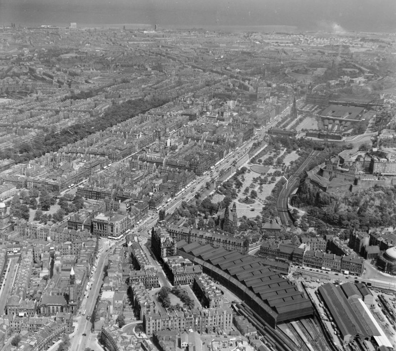 Rutland Square, Princes Street Station foreground, to Waverley and Queen Street Gardens Edinburgh, Midlothian, Scotland. Oblique aerial photograph taken facing North/East.