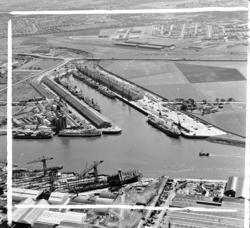 King George V Dock from North Govan, Lanarkshire, Scotland. Oblique aerial photograph taken facing South/West. This image was marked by AeroPictorial Ltd for photo editing.