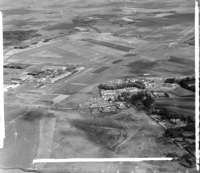 Prestwick Airport Monkton and Prestwick, Ayrshire, Scotland. Oblique aerial photograph taken facing East. This image was marked by AeroPictorial Ltd for photo editing.