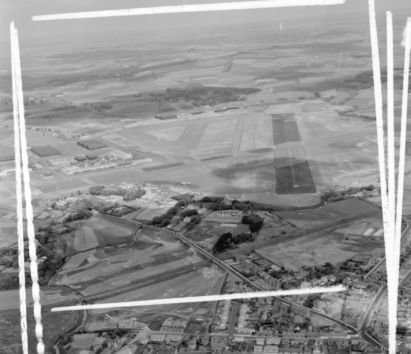 Prestwick Airport Monkton and Prestwick, Ayrshire, Scotland. Oblique aerial photograph taken facing North/East. This image was marked by AeroPictorial Ltd for photo editing.