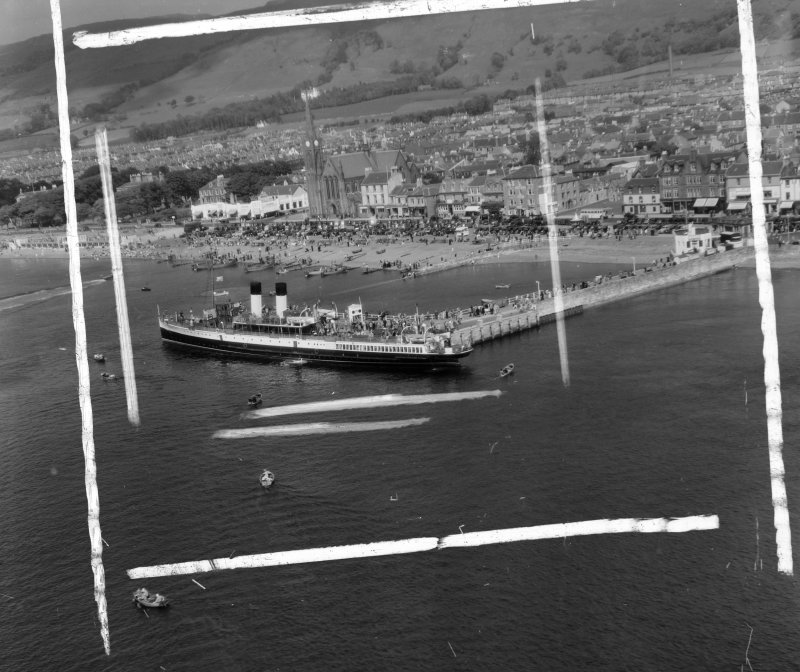 Pier and Steamer Largs, Ayrshire, Scotland. Oblique aerial photograph taken facing North/East. This image was marked by AeroPictorial Ltd for photo editing.