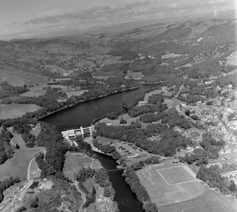 Pitlochry, Loch Tummel Hydro Electric Dam in foreground Moulin, Perthshire, Scotland. Oblique aerial photograph taken facing North/West.