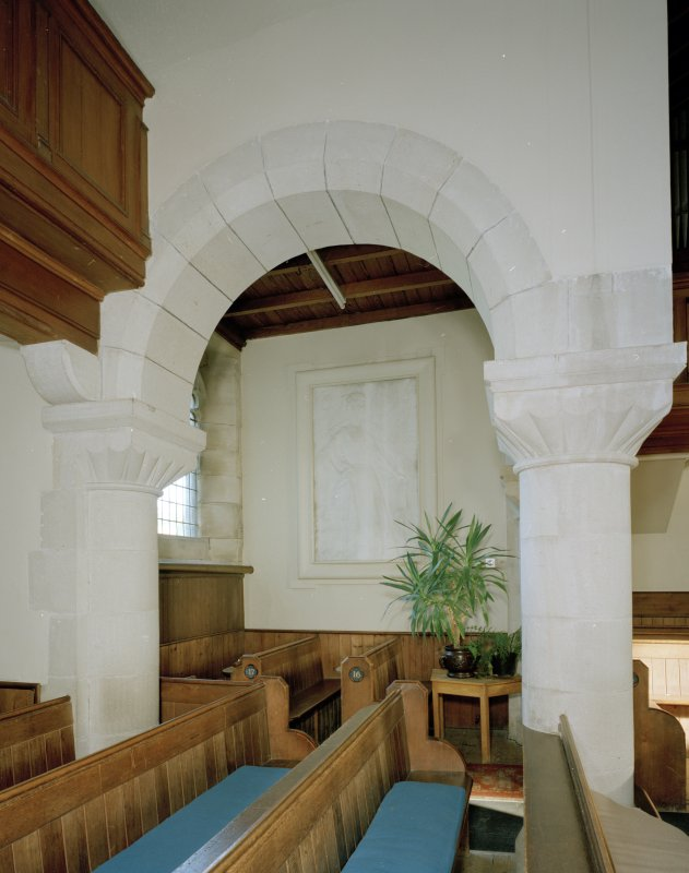 Interior. View of pews and arch.
