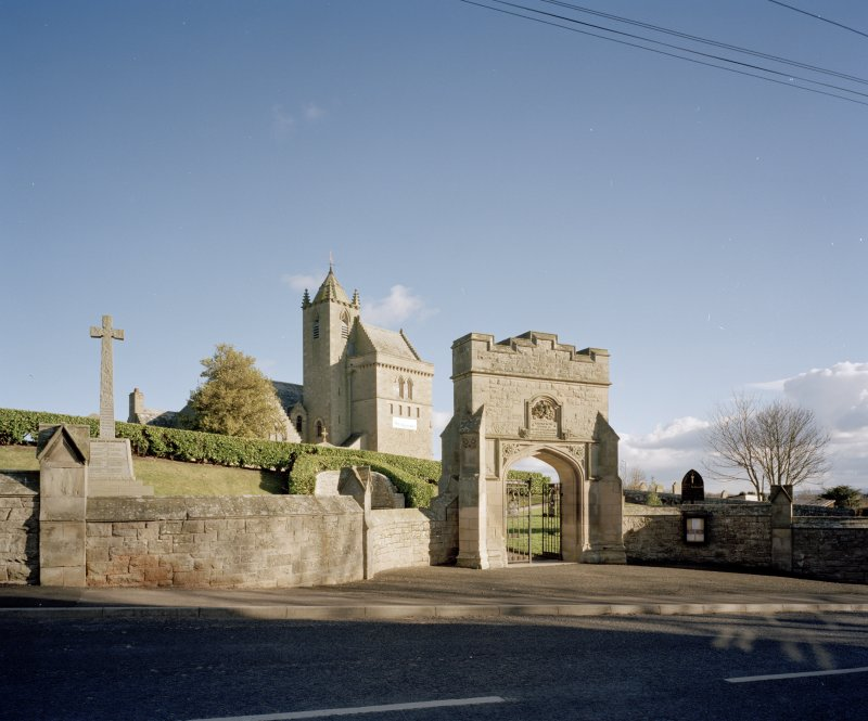 General view of gateway, war memorial and church from NW.