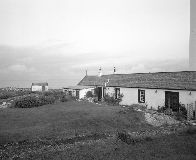 Islay, Rudh A' Mhail, Rhuvaal Lighthouse View from S of SW side of range of keepers' houses, and adjacent out-house (left)