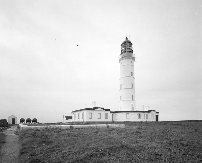 Islay, Orsay, Rhinns of Islay Lighthouse General view from NE of lighthouse showing its position within the inner compound.  Also visible are three air receivers (left), and the foundations of the previously demolished engine house within which Kelvin Diesels powered Alley & McLellan compressor units, producing comressed air for the fog horn
