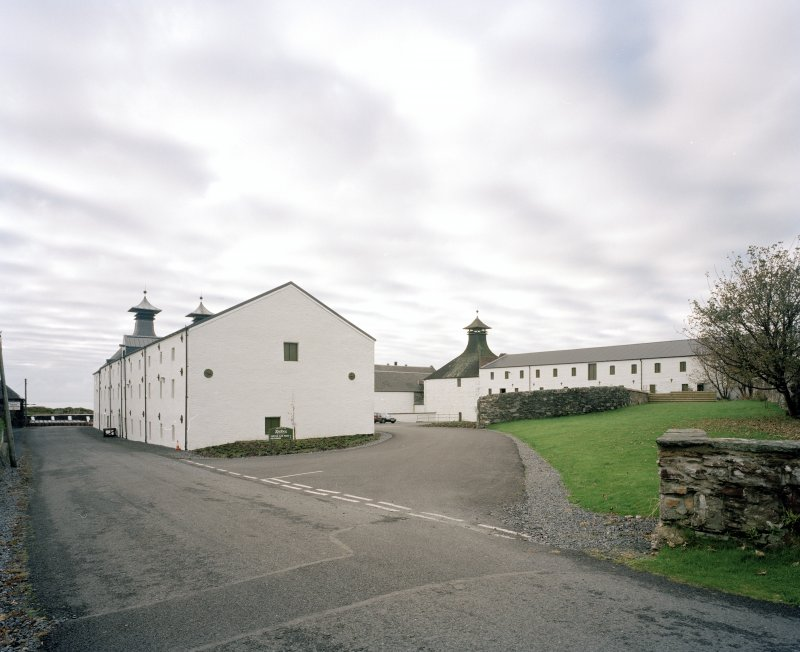 Ardbeg Distillery General view from N of central part of distillery, showing E block of floor maltings and kilns (left) and W block of maltings (right).  The E pair of kilns have been converted into a Visitors' Centre, shop and cafe.