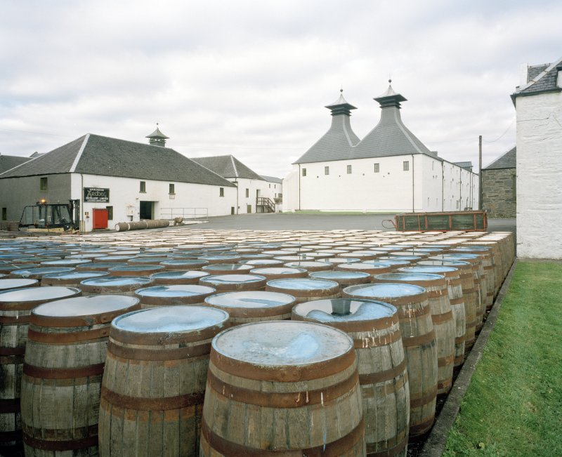 Ardbeg Distillery View with barrels in forebround of two kilns at S end of E maltings