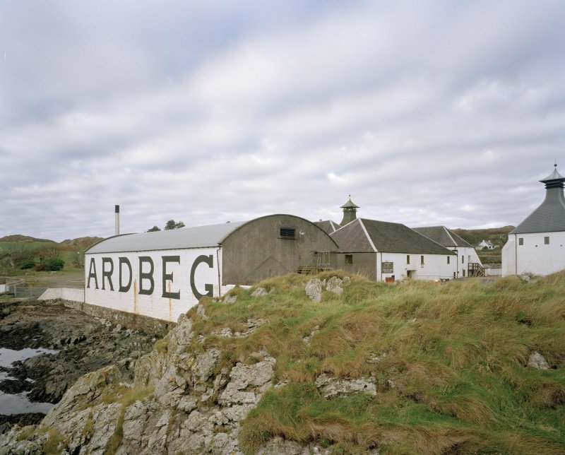 Ardbeg Distillery View from E of S (seaward) side of distillery, showing bonded warehouse bearing the name 'ARDBEG' in large letters, designed to catch the eye of passing ferry passengers
